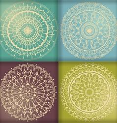 Four circular floral ornaments vector image