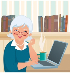 Elderly woman using a laptop vector