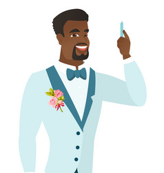 Young african-american smiling groom with pen vector