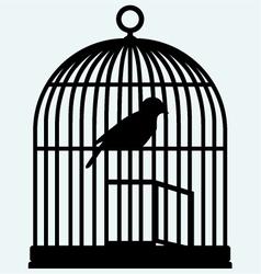 An open birdcage and bird vector image