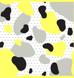 Seamless pattern of yellow gray and black spots vector