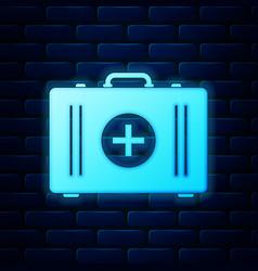 glowing neon first aid kit icon isolated on brick vector image