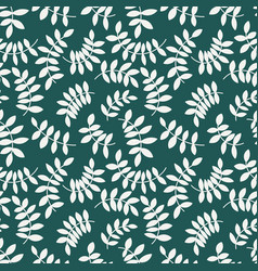 Seamless pattern from leaves and twigs vector