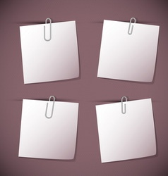 Note papers with paperclip on violet background vector image