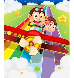 Two monkeys riding in an aircraft vector image vector image