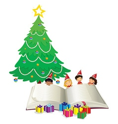 Big book and children by christmas tree vector image