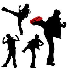 a few kicking girls sport silhouettes karate vector image