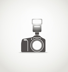 Photo camera sillhouette with the flash vector image vector image