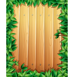 Border design with green leaves on wooden wall vector