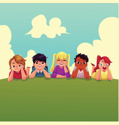 group of happy children lying on green grass vector image vector image