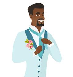 cheerful african-american groom adjusting tie vector image vector image