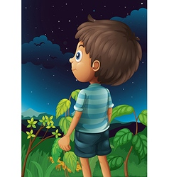A boy gazing at the sky vector image vector image