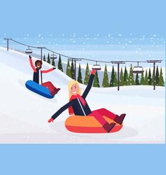 mix race women sledding on snow rubber tube winter vector image