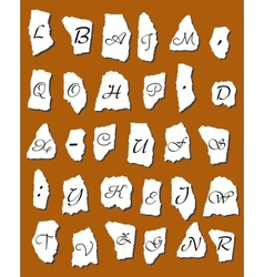 Alphabet letters on scraps of paper vector image
