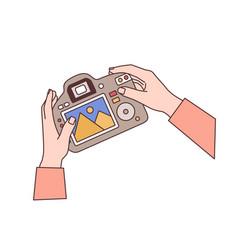 hands holding digital camera flat vector image