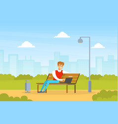 young man using laptop computer while sitting on vector image