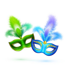 Pair of green and blue masks isolated on vector image