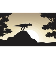Silhouette of mapusaurus at sunrise vector