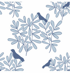 Seamless background with branches and birds vector