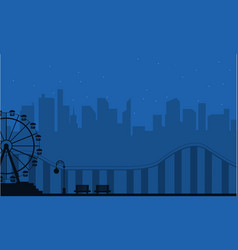 Silhouette amusement park at night scenery vector