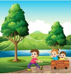 Boys playing at riverbank vector