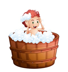 A smiling young boy inside the wooden bathtub vector image vector image