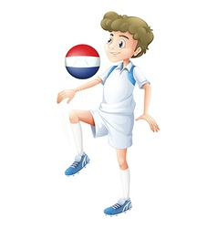 A player using the ball with the flag of vector image vector image