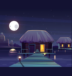 Rich hotel on piles at night vector
