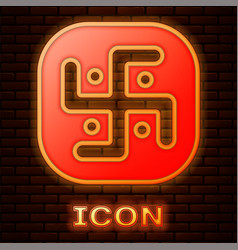 Glowing neon jainism icon isolated on brick wall vector