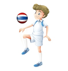 A player using the ball with the flag of Thailand vector image