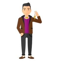 Cheerful man holding keys vector image