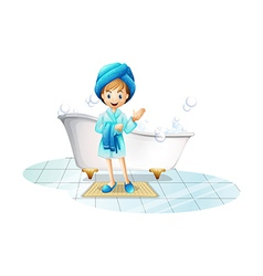 A happy girl wearing a blue robe and a blue shower vector