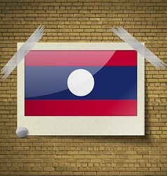 Flags Laos at frame on a brick background vector image vector image