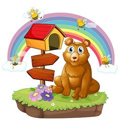 A bear beside a wooden mailbox and a wooden vector image