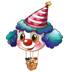 A big clown balloon with a basket full of kids vector image