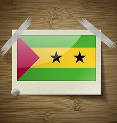 Flags Sao Tome Principe at frame on wooden texture vector image