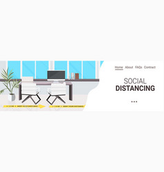 workplace desk with signs for social distancing vector image
