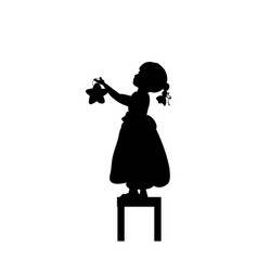 silhouettes child stands on stools holds christmas vector image