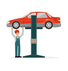 Auto mechanic in uniform standing under red car vector