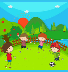 four children playing football in the park vector image