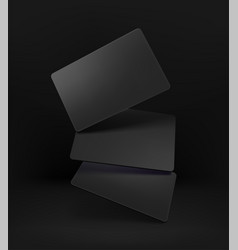 Realistic black cards on black background vector