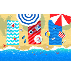beach mats and accessories on sand vector image vector image