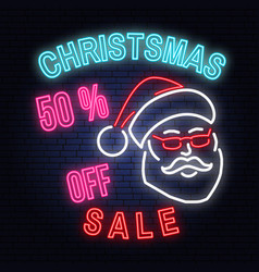 Christmas sale neon sign with santa claus vector