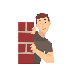 Young man looking from behind corner brick wall vector