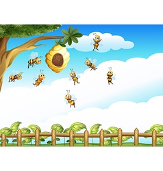 A tree with a beehive and a group of bees vector image vector image