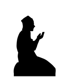 Silhouette of a Muslim praying man vector