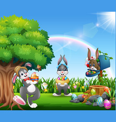 easter bunnies and colorful egg on the garden vector image