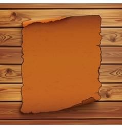 Old orange scroll on wooden planks vector image