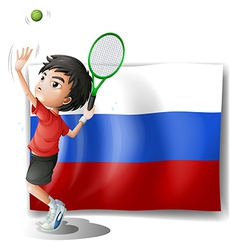 A boy playing tennis in front of the Russian vector image
