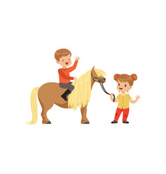 cute little boy jockey sitting on pony horse vector image